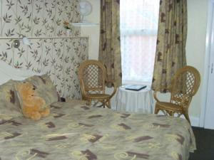The Bedrooms at Sandy Acres Guest House