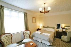 The Bedrooms at Grove House Hotel